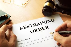 Man issuing restraining order.